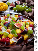 Купить «fruit salad with figs, raspberries, grapes», фото № 29076750, снято 18 августа 2018 г. (c) Oksana Zh / Фотобанк Лори