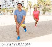 Купить «Couple training on beach», фото № 29077014, снято 26 июня 2018 г. (c) Яков Филимонов / Фотобанк Лори