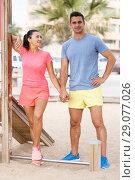 Купить «Sporty couple posing after outdoors workout», фото № 29077026, снято 26 июня 2018 г. (c) Яков Филимонов / Фотобанк Лори