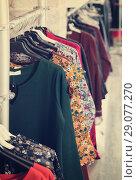 Купить «assortment of colorful clothing in the boutique», фото № 29077270, снято 17 января 2018 г. (c) Яков Филимонов / Фотобанк Лори