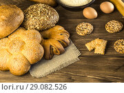 Купить «Food. Baking bread. Fresh bread baked in a bakery, biscuits, chicken eggs and flour on the background of a wooden table texture», фото № 29082526, снято 25 августа 2018 г. (c) Светлана Евграфова / Фотобанк Лори