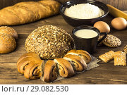 Купить «Food. Baking bread. Fresh bread baked in a bakery, biscuits, chicken eggs and cottage cheese on the background of a wooden table texture», фото № 29082530, снято 25 августа 2018 г. (c) Светлана Евграфова / Фотобанк Лори