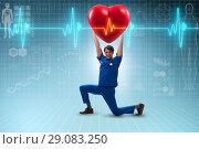 Купить «Man doctor in cardiology telemedicine concept», фото № 29083250, снято 21 ноября 2019 г. (c) Elnur / Фотобанк Лори