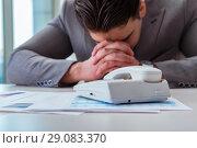 Купить «Businessman expecting important call on phone», фото № 29083370, снято 2 марта 2017 г. (c) Elnur / Фотобанк Лори