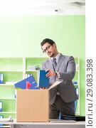 Купить «Male employee collecting his stuff after redundancy», фото № 29083398, снято 14 мая 2018 г. (c) Elnur / Фотобанк Лори