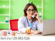 Купить «Woman dentist working on teeth implant», фото № 29083526, снято 11 июня 2018 г. (c) Elnur / Фотобанк Лори