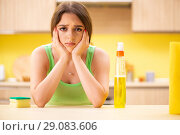 Купить «Young beatifull woman polishing table in the kitchen», фото № 29083606, снято 12 июня 2018 г. (c) Elnur / Фотобанк Лори