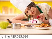 Купить «Young cook cooking cakes in the kitchen», фото № 29083686, снято 12 июня 2018 г. (c) Elnur / Фотобанк Лори