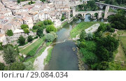 Купить «Aerial view of historic centre of Besalu with Romanesque bridge over Fluvia river, Catalonia, Spain», видеоролик № 29084034, снято 23 июня 2018 г. (c) Яков Филимонов / Фотобанк Лори
