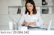 Купить «Attentively female doctor working at laptop in her office», видеоролик № 29084342, снято 23 мая 2018 г. (c) Яков Филимонов / Фотобанк Лори
