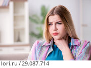 Купить «Young woman suffering from sore throat pain», фото № 29087714, снято 30 марта 2018 г. (c) Elnur / Фотобанк Лори