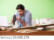 Купить «Woodworker working in his workshop», фото № 29088278, снято 15 мая 2018 г. (c) Elnur / Фотобанк Лори