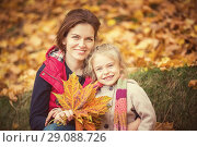 Купить «Mother and daughter in the autumn park», фото № 29088726, снято 4 октября 2016 г. (c) Sergey Borisov / Фотобанк Лори