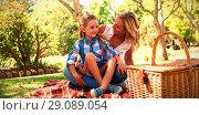 Купить «Daughter sitting on mothers lap while having picnic», фото № 29089054, снято 20 сентября 2018 г. (c) Wavebreak Media / Фотобанк Лори
