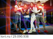 Купить «Friends with laser guns in colored beams», фото № 29090938, снято 25 апреля 2018 г. (c) Яков Филимонов / Фотобанк Лори