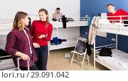 Купить «Polite attractive girl friendly meeting new female neighbor in hostel dormitory», фото № 29091042, снято 22 марта 2018 г. (c) Яков Филимонов / Фотобанк Лори