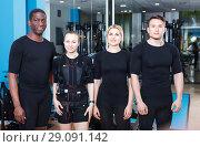 Купить «Team of confident sporty young people dressed EMS vests in modern fitness gym», фото № 29091142, снято 16 апреля 2018 г. (c) Яков Филимонов / Фотобанк Лори