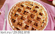 Купить «close up of apple pie and knife on wooden table», видеоролик № 29092818, снято 7 сентября 2018 г. (c) Syda Productions / Фотобанк Лори