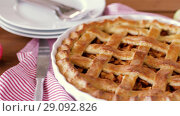 Купить «close up of apple pie and knife on wooden table», видеоролик № 29092826, снято 7 сентября 2018 г. (c) Syda Productions / Фотобанк Лори