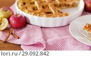 Купить «close up of apple pie with ice cream on plate», видеоролик № 29092842, снято 7 сентября 2018 г. (c) Syda Productions / Фотобанк Лори