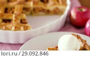 Купить «close up of apple pie with ice cream on plate», видеоролик № 29092846, снято 7 сентября 2018 г. (c) Syda Productions / Фотобанк Лори
