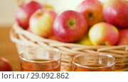 Купить «apples in basket and glasses of juice on table», видеоролик № 29092862, снято 7 сентября 2018 г. (c) Syda Productions / Фотобанк Лори