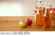 Купить «apples in basket and bottles of juice on table», видеоролик № 29092870, снято 7 сентября 2018 г. (c) Syda Productions / Фотобанк Лори