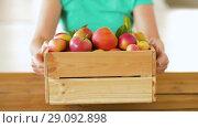 Купить «woman with wooden box of ripe apples», видеоролик № 29092898, снято 7 сентября 2018 г. (c) Syda Productions / Фотобанк Лори