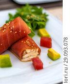 Купить «rolls of tuna with crab meat on the plate», фото № 29093078, снято 27 июня 2017 г. (c) katalinks / Фотобанк Лори