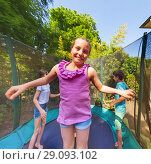 Купить «Cute girl jumping on a trampoline with her friends», фото № 29093102, снято 20 мая 2018 г. (c) Сергей Новиков / Фотобанк Лори