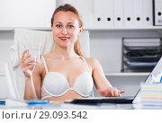 Купить «Woman working in bra at the laptop», фото № 29093542, снято 24 апреля 2017 г. (c) Яков Филимонов / Фотобанк Лори
