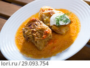 Купить «Cabbage rolls in cabbage leaves with sour cream, dish of European cuisine», фото № 29093754, снято 21 сентября 2018 г. (c) Яков Филимонов / Фотобанк Лори
