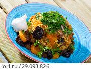 Купить «Pilaf from mutton with dried apricots, prunes», фото № 29093826, снято 17 октября 2018 г. (c) Яков Филимонов / Фотобанк Лори