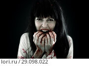 Halloween horror. Crazy bloody scary zombie woman. Стоковое фото, фотограф katalinks / Фотобанк Лори
