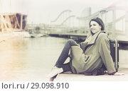 Купить «woman with luggage posing at quay and smiling», фото № 29098910, снято 27 марта 2017 г. (c) Яков Филимонов / Фотобанк Лори