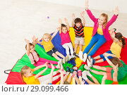 Купить «Happy teacher playing circle games with children», фото № 29099466, снято 15 апреля 2017 г. (c) Сергей Новиков / Фотобанк Лори