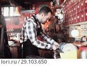 Купить «Worker preparing buckle for belt», фото № 29103650, снято 19 октября 2018 г. (c) Яков Филимонов / Фотобанк Лори