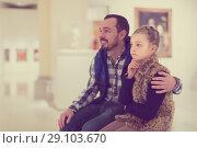 Купить «Father and small daughter looking art paintings», фото № 29103670, снято 22 сентября 2018 г. (c) Яков Филимонов / Фотобанк Лори