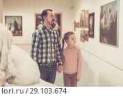 Купить «attractive father and daughter regarding paintings in museum», фото № 29103674, снято 22 сентября 2018 г. (c) Яков Филимонов / Фотобанк Лори