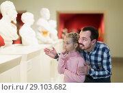 Купить «Man and daughter regarding ancient statues», фото № 29103682, снято 20 сентября 2018 г. (c) Яков Филимонов / Фотобанк Лори