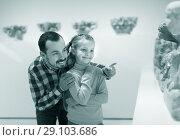 Купить «Man and small daughter looking ancient statues», фото № 29103686, снято 20 сентября 2018 г. (c) Яков Филимонов / Фотобанк Лори