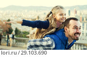 Купить «Happy father and small daughter enjoying city walk», фото № 29103690, снято 20 сентября 2018 г. (c) Яков Филимонов / Фотобанк Лори