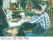 Купить «male worker sewing stitches on belt in leather workshop», фото № 29103754, снято 12 декабря 2018 г. (c) Яков Филимонов / Фотобанк Лори