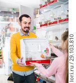 Купить «man seller demonstrating canary bird in cage to girl in pet shop», фото № 29103810, снято 19 января 2017 г. (c) Яков Филимонов / Фотобанк Лори