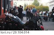 Купить «Motorcycle helmet hanging on the handles of the motorcycle hazy background with people», видеоролик № 29104014, снято 20 сентября 2018 г. (c) Константин Шишкин / Фотобанк Лори
