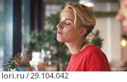 Купить «female friends eating at restaurant», видеоролик № 29104042, снято 23 августа 2018 г. (c) Syda Productions / Фотобанк Лори