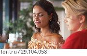 Купить «female friends with smartphone at restaurant», видеоролик № 29104058, снято 23 августа 2018 г. (c) Syda Productions / Фотобанк Лори