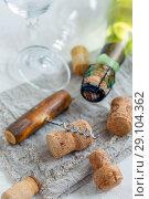 Old corkscrew, glasses and wine corks. Стоковое фото, фотограф Марина Сапрунова / Фотобанк Лори