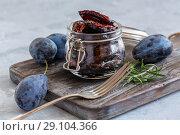 Купить «Spicy dried plums in a glass jar», фото № 29104366, снято 17 сентября 2018 г. (c) Марина Сапрунова / Фотобанк Лори