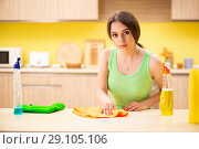 Купить «Young beatifull woman polishing table in the kitchen», фото № 29105106, снято 12 июня 2018 г. (c) Elnur / Фотобанк Лори